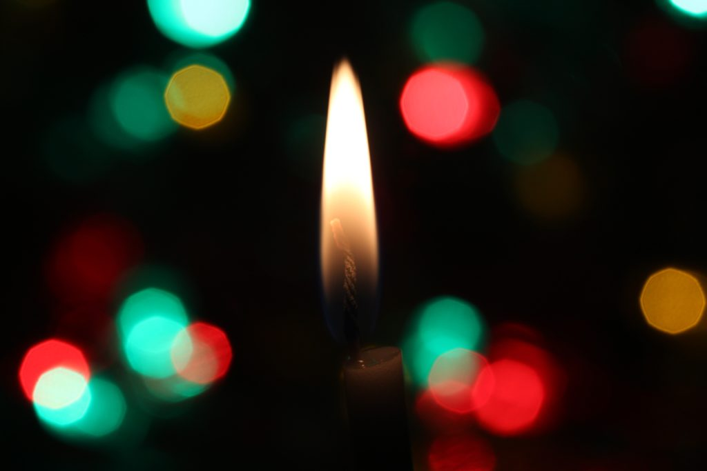 Candle Flame with Colorful Dotted Background